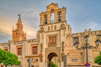 Puerta del Pedon (Door of Forgiveness) with the Giralda tower on the background, Seville, Spain