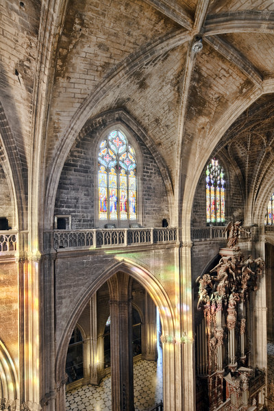 Vantage point view of one of the naves of Santa Maria de la Sede Cathedral, Seville, Spain