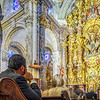 People attending Catholic mass, El Salvador church, Seville, Spain