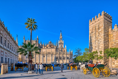 Archivo de Indias (left), Cathedral and Giralda Tower (middle) and Alcazar (right), Seville, Spain.