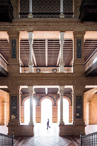 Visitors inside Plaza de España, Seville, Spain