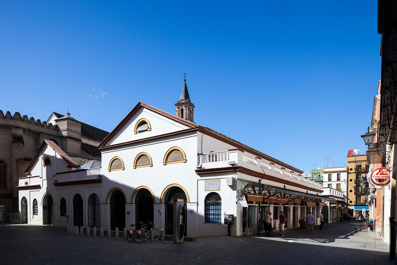 Feria street marketplace and Omnium Sanctorum church (13th century), Seville, Spain