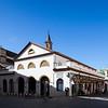 Feria street marketplace and Omnium Sanctorum church (13th century), Seville, Spain