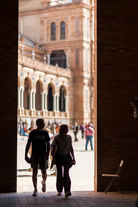 People entering Plaza de España square, Seville
