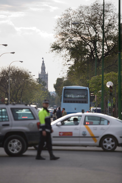 Traffic policeman, Seville, Spain. The Giralda tower on the background