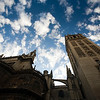 Low angle view of the Giralda tower and Seville's Cathedral against a dramatic sky