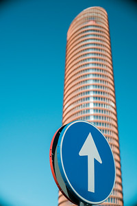 Traffic sign in front of Torre Sevilla skyscraper, Seville, Spain
