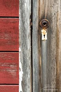 Broken door handle and old lock on ghost town in Kennicott, Alaska