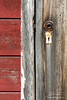 Broken door handle and old lock on ghost town in Kennicott, Alaska