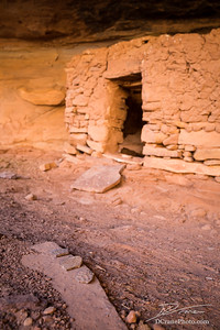Potsherds on rock near entrance of pueblo dwelling