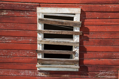 Boarded up window in ghost town of Kennicott, Alaska. Formerly a major mining town, it was abandoned and now being restored for tourism
