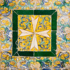 Cross on old glazed ceramic tiles, Fine Arts Museum, Seville, Spain
