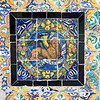 Saint Mark symbol on old glazed ceramic tiles, Fine Arts Museum, Seville, Spain