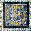 Saint John symbol on old glazed ceramic tiles, Fine Arts Museum, Seville, Spain