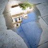 Belfry reflected on a puddle, cloister of the Fine Arts Museum, Seville, Spain