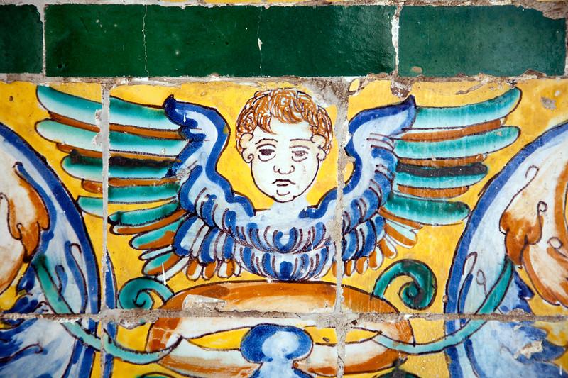 Cherub on old glazed ceramic tiles, Fine Arts Museum, Seville, Spain