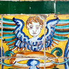 Cherub on old glazed ceramic tiles, Fine Arts Museum, Seville, Spain