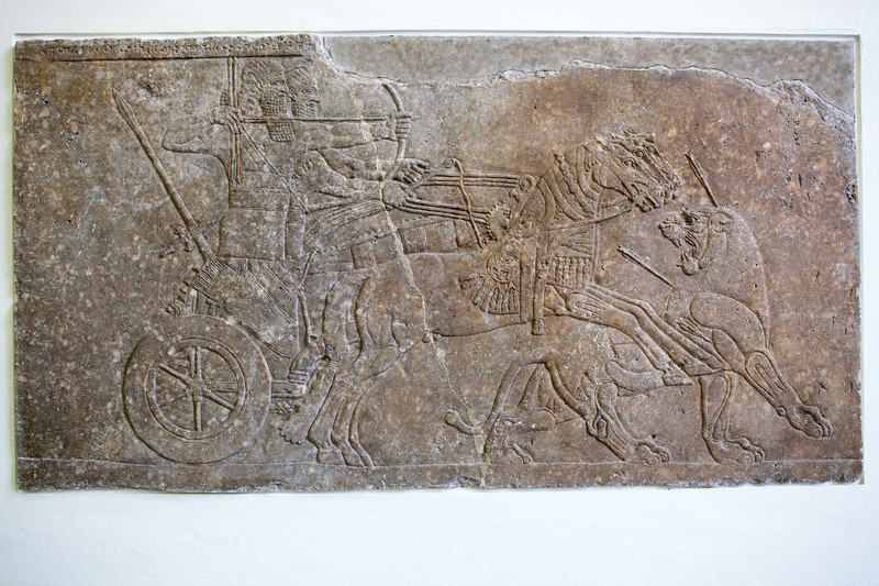 Relief showing the Assyrian king Ashurnasirpal II (9th century BC) hunting a lion, Pergamon Museum, Berlin, Germany