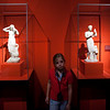 Young visitor between two Aphrodite figures, Pergamon Museum, Berlin, Germany