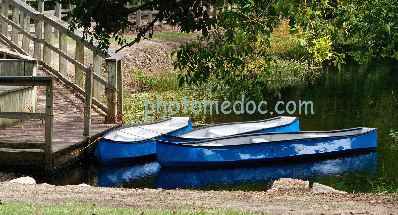 3 Blue Rowboats