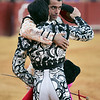 The bullfighters Uceda Leal and Fernando Cruz (backwards) hug. Bullfight at Real Maestranza bullring, Seville, Spain, 15 August 2006.