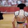 Bullfighter looking at the bull. Bullfight at Real Maestranza bullring, Seville, Spain, 15 August 2006.