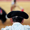 Assistant bullfighter looking at his boss performance. Bullfight at Real Maestranza bullring, Seville, Spain, 15 August 2006.