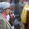 Man smoking a cigar in the callejon, or the ring close to the barrier. Bullfight at Real Maestranza bullring, Seville, Spain, 15 August 2006.