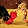 Anibal Ruiz stabbing a bull. Bullfight at Real Maestranza bullring, Seville, Spain, 15 August 2006.