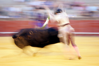 Motion blurred action by a banderillero. Bullfight at Real Maestranza bullring, Seville, Spain, 15 August 2006.