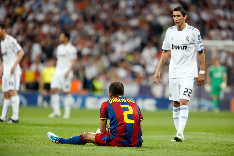 Alves sitting on the ground, UEFA Champions League Semifinals game between Real Madrid and FC Barcelona, Bernabeu Stadiumn, Madrid, Spain