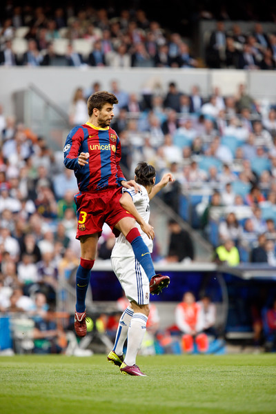 Pique jumping before Ozil, UEFA Champions League Semifinals game between Real Madrid and FC Barcelona, Bernabeu Stadiumn, Madrid, Spain