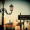 Sign of Gondola Service at the Piazzetta, with San Giorgio Maggiore on the background, Venice, Italy