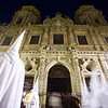 Hooded penitents in front of San Luis church, Holy Week, Seville, Spain