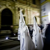 Panning of hooded penitents, Holy Week, Seville, Spain