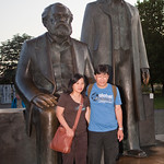 Asian couple posing in front of Marx and Engels statues, Marx-Engels-Forum, Berlin, Germany