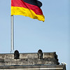 German flag on the top of one of the Reichstag towers, Berlin, Germany