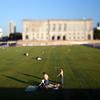 People sunbathing on Schlossplatz, Berlin, Germany. Tilted lens used for shallow depth of field.