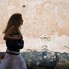 Walker against an old wall, Spain