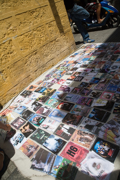 Illegal copies of music and movies on sale on the street, Cadiz, Spain