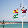 Mast with the Spanish, Andalusian and Cadiz flags at La Caleta, Cadiz, Spain