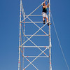 Worker on the top of a scaffolding