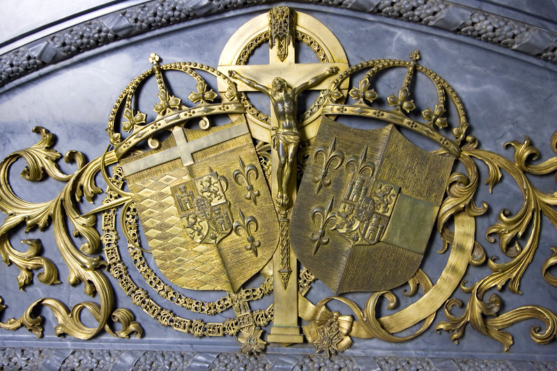 Crucifix and Coats of Arms on a Royal Tomb, El Escorial, Spain