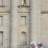 A couple of women before the huge columns of El Escorial facade, Spain