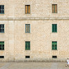A Woman in front of El Escorial facade