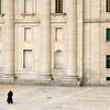 Old Monk walking in front of El Escorial Monastery