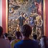 Visitors admiring a painting by El Greco, El Escorial, Madrid