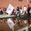 Sevilla FC fans reflected on a puddle