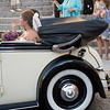 Bride and groom and old-fashioned car
