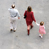 Three generations of a family walking together